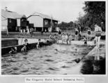 Picture relating to Kingaroy - titled 'Schoolchildren frolicking in the pool at Kingaroy State School'