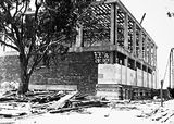 Picture relating to Acton - titled 'Australian Institute of Anatomy under construction. Fitting the sandstone finish. McCoy Circle, Acton.'