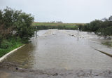 Picture relating to Point Hut Crossing - titled 'Point Hut Crossing - ACT - in flood.'