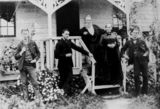 Picture relating to Stanthorpe - titled 'Lewis Perkins with his wife and sons in front of their home, Stanthorpe, ca. 1874'