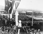 Picture of / about 'Parliament House' the Australian Capital Territory - Royal Visit, May 1927 - Troops, spectators, official guests and Army Band outside Old Parliament House.