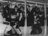 Picture relating to Brisbane - titled 'Strap hangers on a crowded Brisbane tram, 1937'