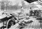 Picture relating to Duaringa - titled 'Loading supplies onto a wagon at the Duaringa Railway Station, Queensland, ca.1902'