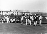 Picture relating to Parliament House - titled 'Visit by the Ashfield Bowling Club of Sydney. Game of bowls on Old Parliament House greens.'