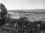 Picture relating to Mount Ainslie - titled 'View from Mount Ainslie along Anzac Avenue towardsOld Parliament House'