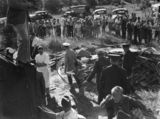 Picture relating to Camp Mountain - titled 'Female train accident survivor is carried away by rescue workers at Camp Mountain, 1947'