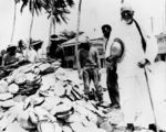 Picture relating to Thursday Island - titled 'Professor Watson with others standing near pearl shells on Thursday Island'