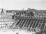 Picture relating to Manuka - titled 'Manuka swimming pool, under construction, pouring concrete for the walls, Manuka Circle, Kingston.'