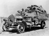 Picture relating to Longreach - titled 'Durkopp truck loaded with stores in the Longreach district, ca. 1912'