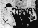 Picture relating to Brisbane - titled 'Air raid warden and members of the W.A.A.F in a Brisbane air raid shelter, 1942'