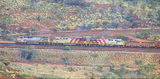 Picture relating to Mount Nameless - titled 'Iron Ore Train from Mount Nameless summit'