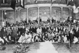 Picture relating to Jimbour - titled 'Guests at Jimbour House pose on the front steps under floodlights, 1925'