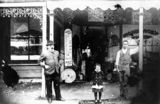 Picture relating to Stanthorpe - titled 'Herman Ritscher standing in front of his ironmongery business in High Street Stanthorpe, ca. 1905'