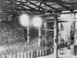 Picture relating to Mossman - titled 'Interior view of a sugar mill at Mossman, Queensland, ca. 1925'