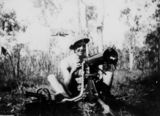 Picture relating to Townsville - titled 'Soldier sitting behind a machine gun, Townsville, 1942'