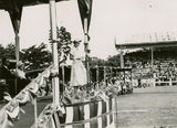Picture relating to Mackay - titled 'Queen Elizabeth II addressing the crowds in Mackay, Queensland on her tour to Australia, 1954'