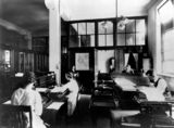 Picture relating to Brisbane - titled 'Employees working at their desks in the Government Printing Office, George Street, Brisbane, 1921'