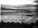 Picture relating to Reid - titled 'View from Mount Ainslie over Reid and Hotel Canberra to Yarralumla'