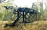 Picture relating to Neeworra - titled 'Burnt out trestle on approach to the rail bridge across the Boomi River, Neeworra'