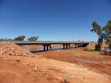 Picture relating to Newman - titled 'Bridging the Fortescue River.'