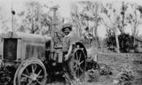 Picture relating to Callide - titled 'Farmer next to a tractor, Callide Valley, ca. 1936'