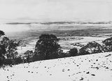 Picture relating to Duntroon - titled 'Snow fall - View from Red Hill over Collins Park, Manuka and Kingston to Duntroon .'