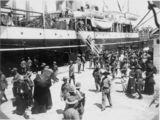 Picture relating to Brisbane - titled 'Soldiers farewell friends and family before boarding ship at the Pinkenba Wharf, Brisbane, ca.1915'