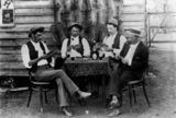 Picture relating to Gin Gin - titled 'Men playing cards at Gin Gin, Queensland, 1890-1900'
