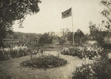 Picture relating to Boonah - titled 'Garden archway and the circular flower beds in full bloom at Coochin Coochin, ca.1920'