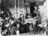Picture relating to Newmarket - titled 'Afternoon tea on the verandah of 'Sedgley Grange', Newmarket, Brisbane, 1900-1910'