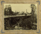 Picture relating to Mackay - titled 'Looking north across the bridge towards Homebush Mill, Mackay, ca. 1895'