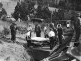 Picture relating to Camp Mountain - titled 'Rescue workers remove a body from a railway carriage at Camp Mountain, 1947'