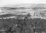 Picture relating to Ainslie - titled 'View from Mt Ainslie over Ainslie Avenue including Reid, Braddon and Civic Centre etc, Ainslie Hotel and Gorman House, Reid to the right.'