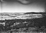 Picture relating to Black Mountain - titled 'Reid and Braddon from Mt Ainslie, Ainslie Hotel on right, Civic Centre in centre, Black Mountain on the horizon.'