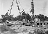 Picture relating to Acton - titled 'Foundations of Australian Institute of Anatomy with cranes, McCoy Circle Acton.'