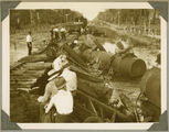 Picture relating to Bundaberg - titled 'Inspecting a train derailment near Bundaberg, ca. 1930'