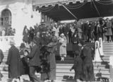 Picture relating to Parliament House - titled 'Royal Visit, May 1927 - Canberra citizens passing the Duke and Dutchess of York on the steps on Old Parliament House at the Civic Reception.'