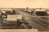 Picture relating to Mackay - titled 'Wide unsealed roads and wooden buildings of early Mackay'