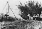 Picture relating to Queensland - titled 'Family group pose with an artesian bore'