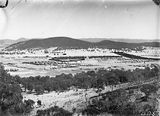 Picture relating to Griffith - titled 'Kingston, Griffith and Red Hill from Mt Ainslie. Molonglo River through the centre.'
