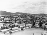 Picture relating to Canberra - titled 'Commonwealth Avenue, Hotel Canberra and Albert Hall from West Block Offices.'