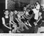 Picture relating to Brisbane - titled 'Brisbane schoolchildren waiting to be immunised against diphtheria, 1943'