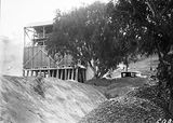Picture relating to Mugga Quarry - titled 'Stone crushing plant and aggregate storage bins, Mugga Quarry.'