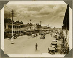 Picture relating to Bundaberg - titled 'Cars and buses fill the main street, Bundaberg, ca. 1930'
