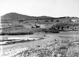 Picture relating to Russell - titled 'Crawler tractors and scoop excavating for a road and bridge at Scotts Crossing near the Monoglo River. Mount Ainslie on left, Russell Hill on right. Blundel cottage on right.'