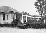 Picture relating to Canberra - titled 'Canberra Community Hospital building with baby Austin 7 Tourer Car'