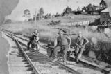 Picture relating to Cooran - titled 'Railway workers near the gatehouse in Cooran, ca. 1930'
