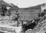 Picture relating to Cotter Dam - titled 'Cotter Dam wall and stilling pond at the base of the wall'
