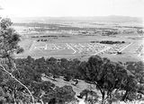 Picture relating to Reid - titled 'View from Mt. Ainslie looking towards St John's church and Reid, Canberra.'