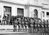 Picture relating to Duntroon - titled 'ANZAC Day 1928 - Duntroon Royal Military College Cadets on parade and part of the crowd in front of Old Parliament House'